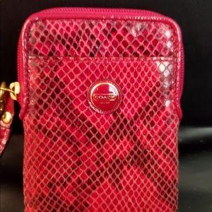 Woman's wallet coach snake skin